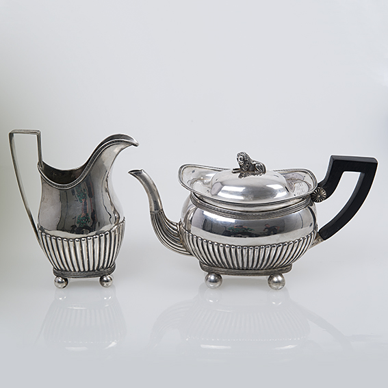 Antiek Hollands zilveren theepot met roomkan